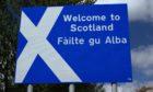 Scottish border sign in English and Gaelic.