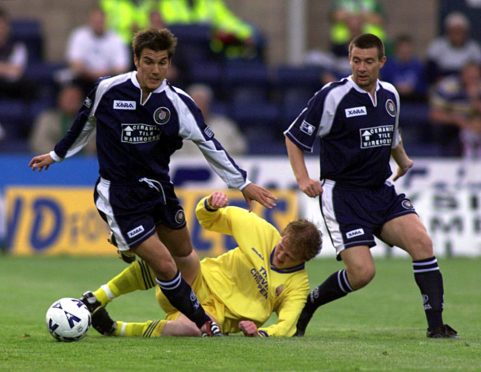 Mike Yates in action for Dundee.
