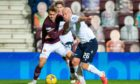 Charlie Adam battles with Olly Lee in Dundee's defeat to Hearts.