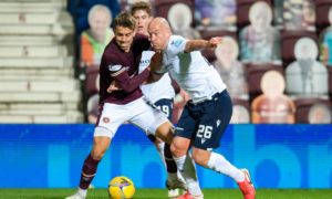 Charlie Adam battles with Olly Lee in Hearts' 6-2 win over Dundee on Friday night.