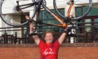 Triumphant charity cyclist Claire Penman at the Carnoustie finish line.