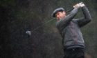 Robert Rock battled through the rain to lead after three rounds at The Renaissance Club.