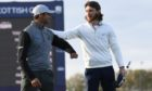 Tommy Fleetwood congraultates Aaron Rai after the play-=off at The Renaissance.