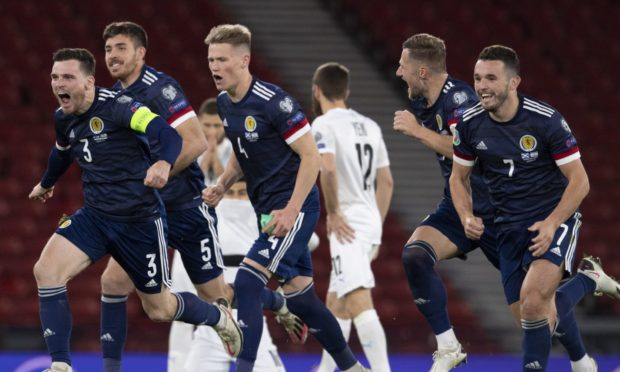 Scotland stars celebrate shoot-out win over Israel.