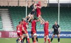 Scarlets' Blade Thomson fights for lineout ball with Ryan Wilson at a spectator-less Scotstoun.