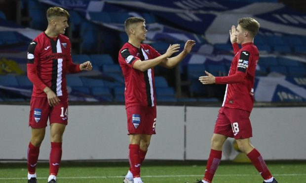 Dunfermline's Fraser Murray (centre) celebrates his second goal at Rugby Park.