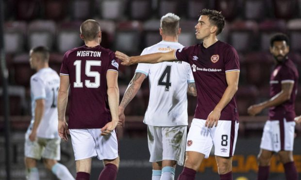 Hearts' Craig Wighton (L) and Olly Lee at full-time.