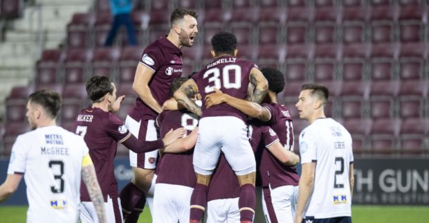 Hearts celebrate the first of their six goals against Dundee.