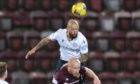 Dundee's Jordan Forster wins a header against Hearts' Liam Boyce.