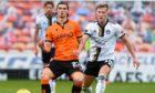 Ross McCrorie of Aberdeen closes in on Dundee United midfielder Ian Harkes.