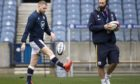 Scotland's Finn Russell (left) with assistant coach Mike Blair.