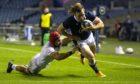 Hamish Watson scores Scotland's third try against Georgia.