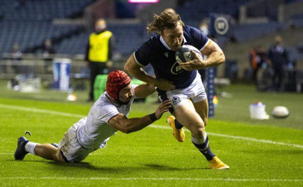 Hamish Watson scores Scotland's third try against Georgia.