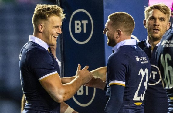 Scotland's Duhan van der Merwe thanks Finn Russell for the assist for his debut try against Georgia.