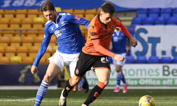 St Johnstone midfielder Murray Davidson puts Dundee United hitman Lawrence Shankland under pressure.