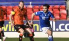 Dundee United skipper Mark Reynolds chases St Johnstone winger Craig Conway.