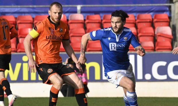 Dundee United skipper Mark Reynolds chases St Johnstone winger Craig Conway.