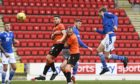 Craig Conway shields the ball from Dundee United's Mark Reynolds at McDiarmid Park.