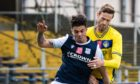 DUNDEE, SCOTLAND - OCTOBER 24: Dundee's Declan McDaid (left) holds off Morton's Brian McLean during a Scottish Championship match between Dundee and Greenock Morton at Dens Park, on October 24, 2020, in Dundee, Scotland. (Photo by Ross Parker / SNS Group)
