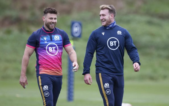 Ali Price (left) with captain Stuart Hogg during training with Scotland.