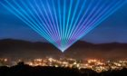 To go with story by Jamie Buchan. Laser show over Pitlochry organised by Enchanted Forest Community Trust Picture shows; Lasers over Pitlochry. Pitlochry. Courtesy Supplied by Volpa PR Date; 02/10/2020