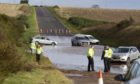 Vehicles stranded on the A92 between Arbroath and Montrose near Inverkeilor after severe flooding.