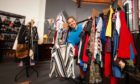 The highly successful West End Community Fridge, run by the Gate Church Carbon Saving Project in Dundee has now been joined by the Community Wardrobe.    Piic shows Gate Church Volunteer Lizzie Bertelsen with some of the garments.  ....Pic Paul Reid