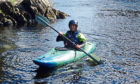 Gayle Ritchie enjoying a kayaking session on the River Spey.