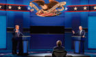 President Donald Trump, left, and Democratic presidential candidate former Vice President Joe Biden, right, with moderator Chris Wallace, center, of Fox News during the first presidential debate on Sep 29