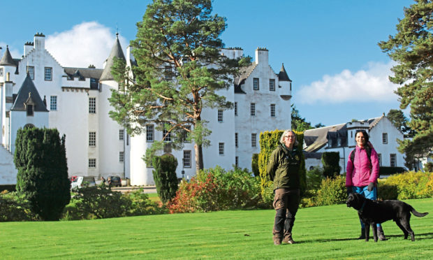 Atholl Estates ranger Julia Duncan with Gayle Ritchie and her dog Toby outside Blair Castle.