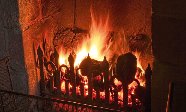 Jim Smith appreciates a roaring log fire.