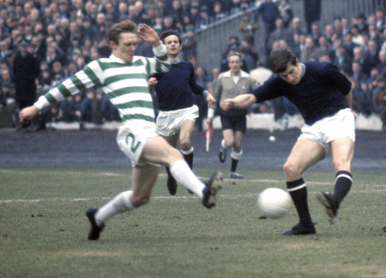 Celtic's Davie Hay tackles Gordon Wallace during 1970 Scottish Cup semi-final at Hampden.