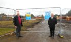 Mr Caldwell, left, and SNP councillor John OBrien at the site of the care village.