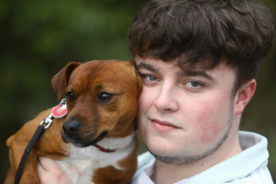 Ally McLaren at home near Blairgowrie today, reunited with his dog Harvey, which was found more than 400 miles away.
