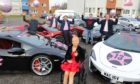 Lily Douglas with the supercars and their drivers
