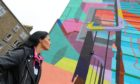 Gayle checks out an OpenClose Dundee mural on Cardean Street.