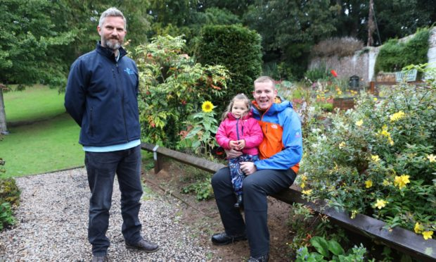 Martin McDonald, Silverburn Park operations manager, left, operations manager at Silverburn Park, with plumber Ross Moreland and his two-year-old daughter Rylee.