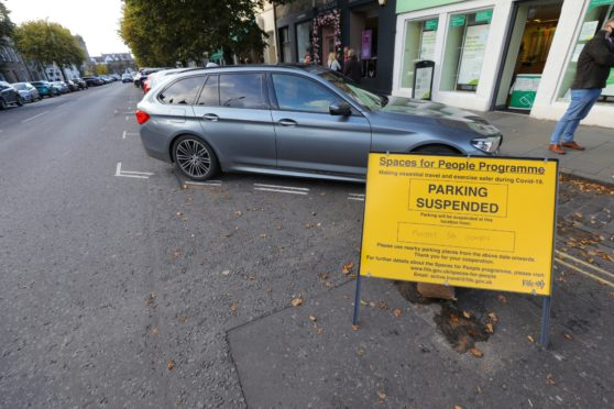 A sign in St Andrews warning of parking restrictions for the Spaces For People measures.
