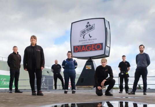 Pictured left to right are Gavin Brogan (Operations Director), Lorraine Johnstone (Longest serving employee), Jason McEvoy (Engineering Manager), Danielle O?Sullivan (Apprentice Mechanical Engineer), Kyle McLean (Apprentice Electrical Engineer), Euan Simpson (Apprentice Mechanical Engineer), Bobby Rintoul (FCE Group) . Leven. Courtesy Diageo Date; Unknown