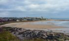 Walking along the coastal path above St Andrews