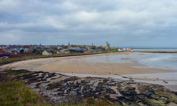 Walking along the coastal path above St Andrews