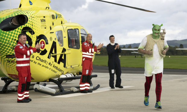 Helicopter pilot Dave Young completed his sponsored 13km run around Perth Airport, raising money for SCAA.