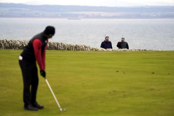 Aaron Rai putts watched by tournament spotters on the first day of the Scottish Championship.