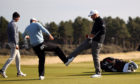 England's Lee Westwood (right) and Ian Poulter bump feet after finishing their second round at The Renaissance.