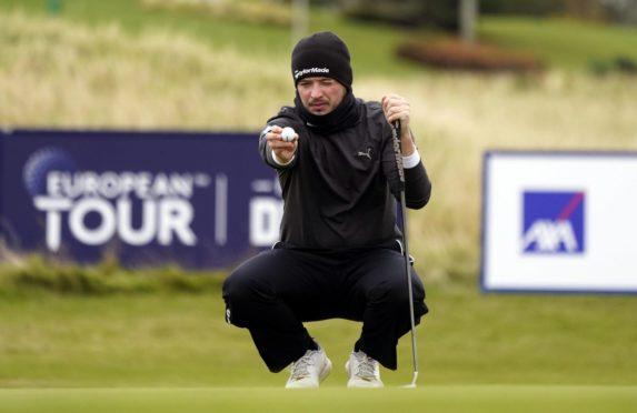 Ewen Ferguson lines up a putt on the ninth green during day one of The Scottish Championship at Fairmont St Andrews.
