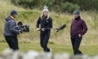 Scotland's Marc Warren is interviewed by Sky Sports' Iona Stevenson the 12th during yesterday's play at Fairmont St Andrews.