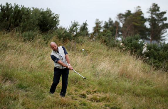 Scotland's Craig Lee chips onto the 17th green during the first round of the Aberdeen Standard Investments Scottish Open.
