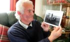 John Sibbit, now 78, with a photograph of the truck he drove to Aberfan.