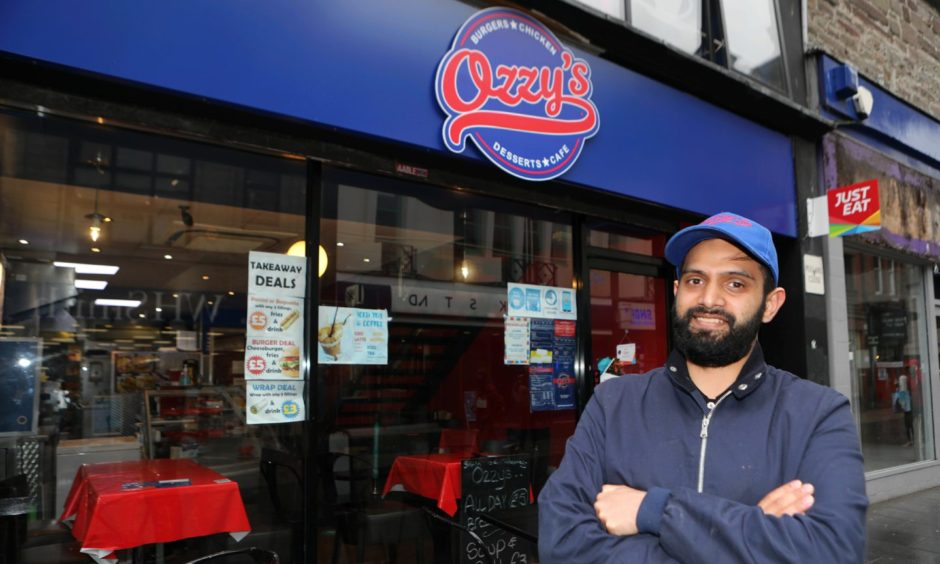 """Usman """"Ozzy"""" Hyatt at his cafe in the Murraygate Dundee."""