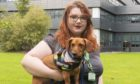 Dundee and Angus College student Isla Gray with Dachshund Belly.